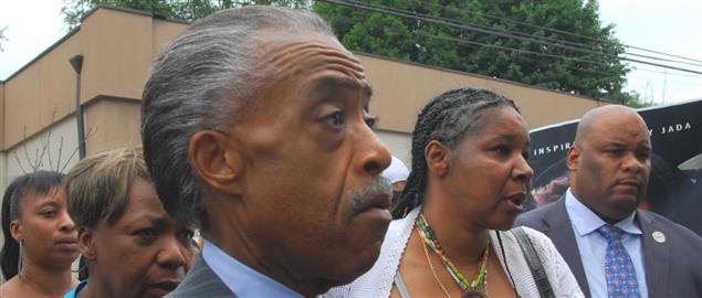 Sharpton at a 2014 protest for Eric Garner, a NYC man who died in police custody