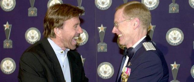 General John W. Handy presents Chuck Norris with Veteran of the Year award
