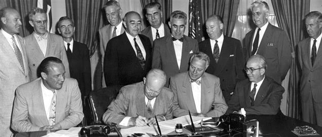 President Eisenhower signs H.R. 9757, an act