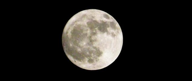 Full moon showing in the clear night sky view, in  Clydebank, Scotland, 3/26/2013.