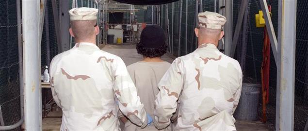 Troopers transport a detainee to the detainee hospital in Guantanamo Bay