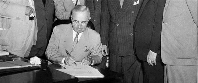 President Harry Truman signing the Atomic Energy Act of 1946
