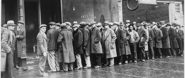 Men standing outside of an Al Capone run soup kitchen during the Great Depression