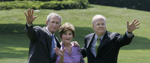 President George W. Bush stands with Mrs. Laura Bush and Deputy Chief of Staff Karl Rove