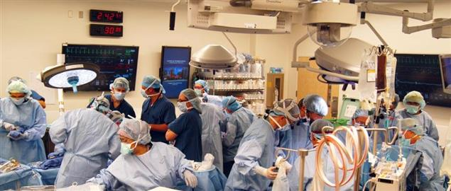 Surgeons operating on a patient at Johns Hopkins Hospital in Baltimore, MD