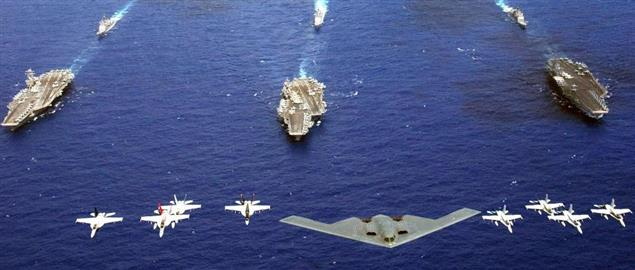 Air Force, Navy and Marine Corps fly over USS carriers in western Pacific Ocean.