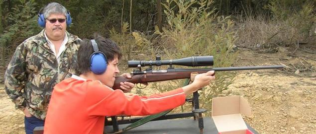 A youth shooting a Mauser hunting rifle.