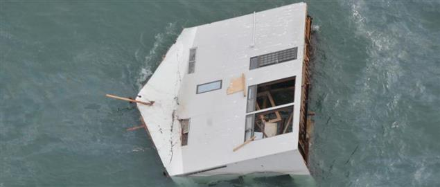 Floating house witnessed by U.S. Air Force search and rescue, 2011 Japanese earthquake