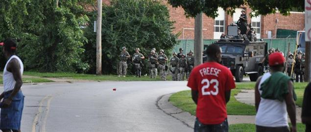 The militarized police approaching a group of protestors in Ferguson, Missouri