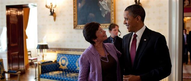 President Obama speaking with Valerie Jarrett in 2010