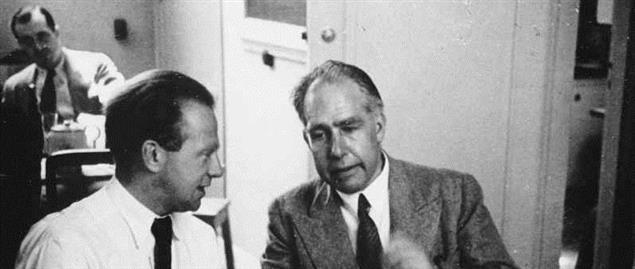Werner Heisenberg (left) with Bohr at the Copenhagen Conference in 1934