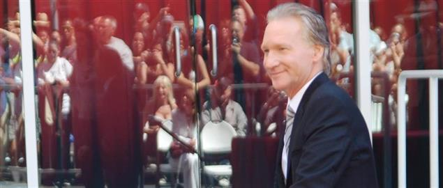 Bill Maher next to his star at a ceremony on the Hollywood Walk of Fame.